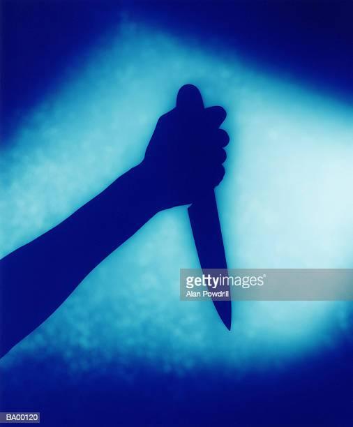 person holding dagger, shadow (blue tone) - 刺傷事件 ストックフォトと画像