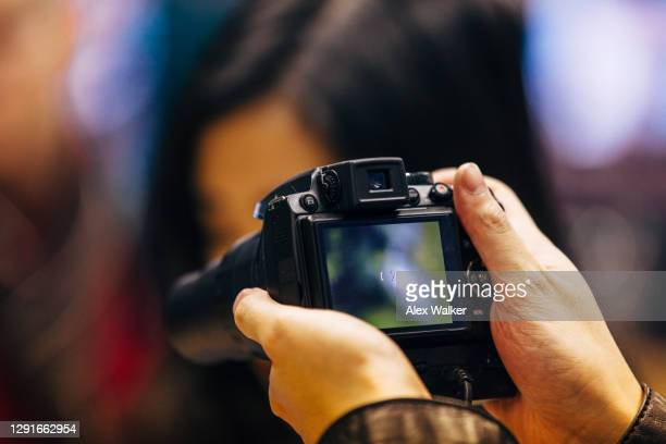 person holding digital camera with lcd screen - photo messaging stock pictures, royalty-free photos & images