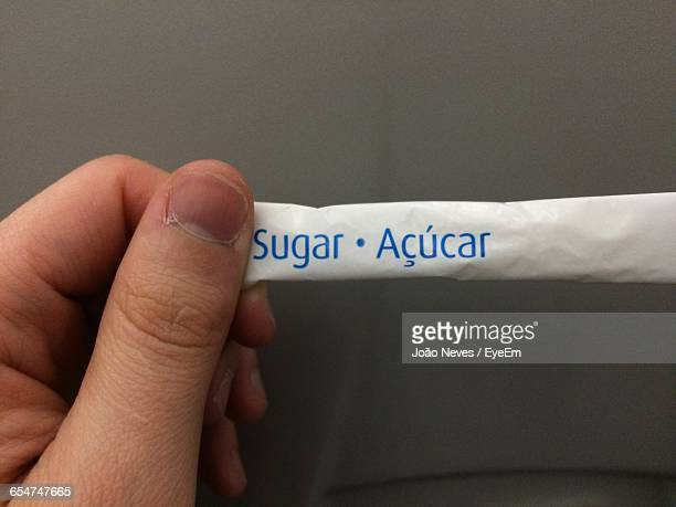 Person Holding Drink Sweetener
