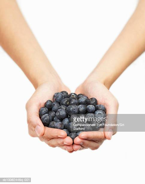 "person holding handful of blueberries, close-up of hands - ""compassionate eye"" stock pictures, royalty-free photos & images"