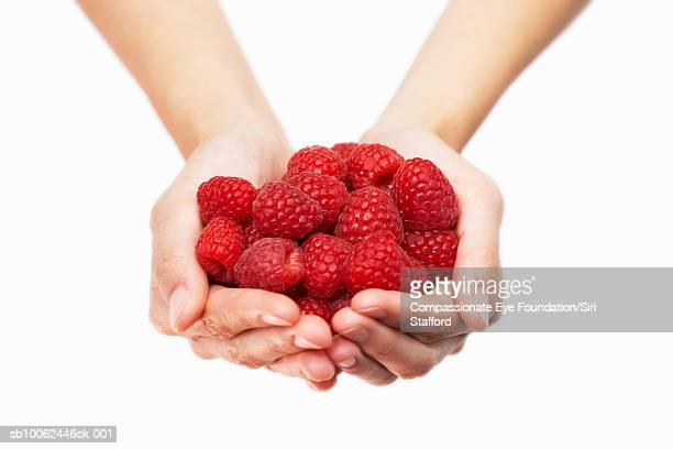 "person holding handful of raspberries, close-up of hands - ""compassionate eye"" stock pictures, royalty-free photos & images"