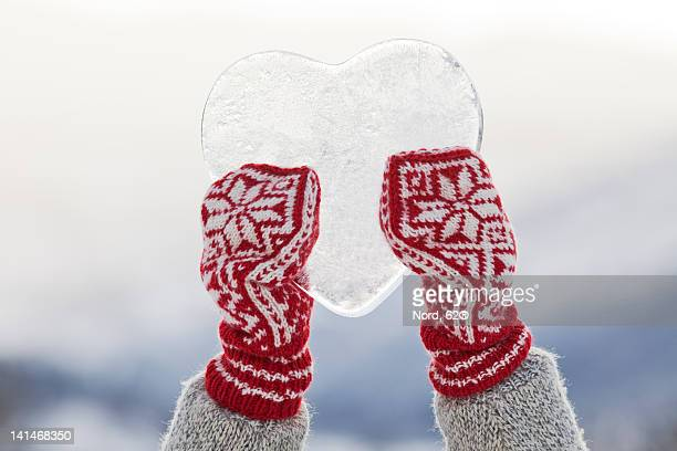 person holding heart shaped ice - mitten stock pictures, royalty-free photos & images
