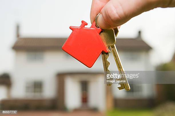 person holding house keys - house key stock photos and pictures