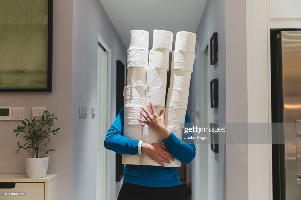 Person holding large piles of toilet rolls : Stock Photo