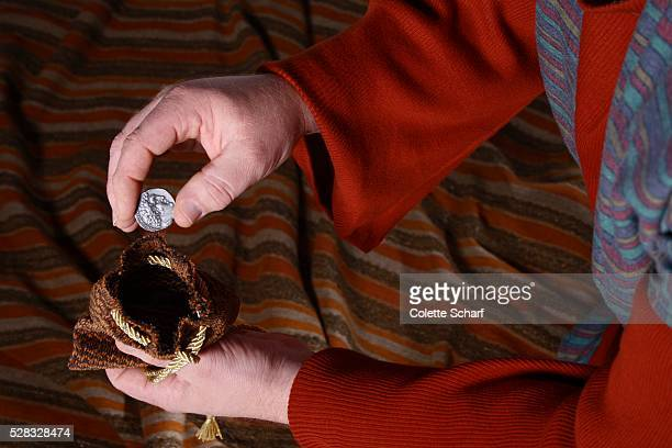 person holding money - judas iscariot stock pictures, royalty-free photos & images