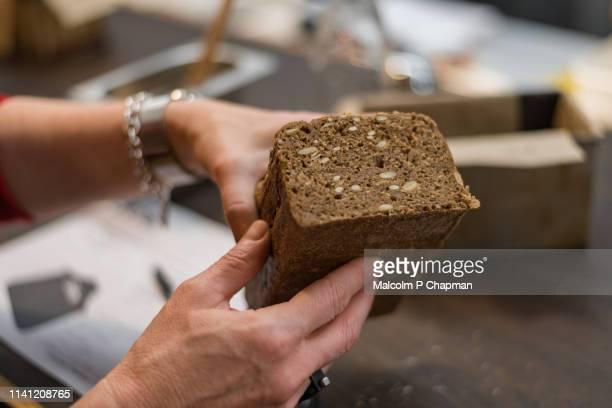 Person holding Nordic Sourdough Rye Bread