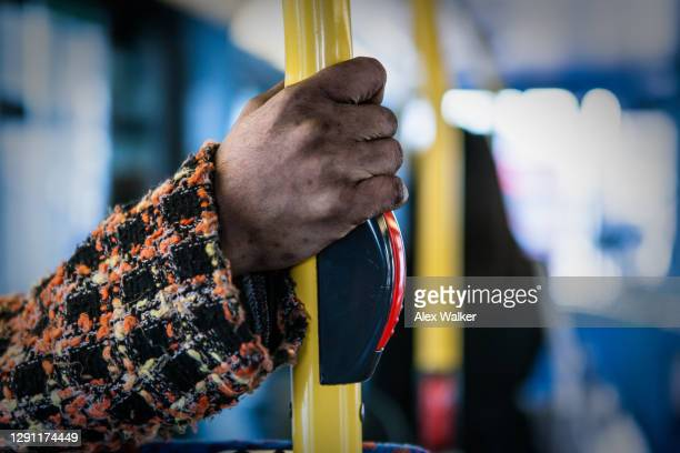 person holding onto railing on bus - public transport stock pictures, royalty-free photos & images