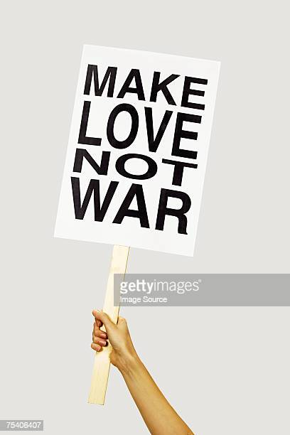 person holding placard - demonstration stock pictures, royalty-free photos & images