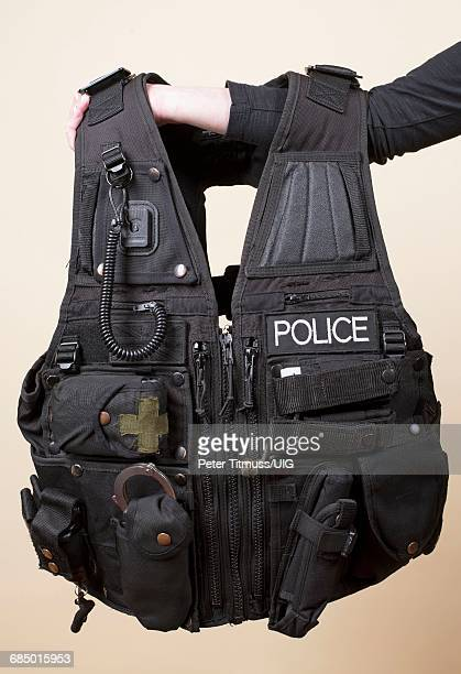 person holding police tactical vest - swat stock pictures, royalty-free photos & images