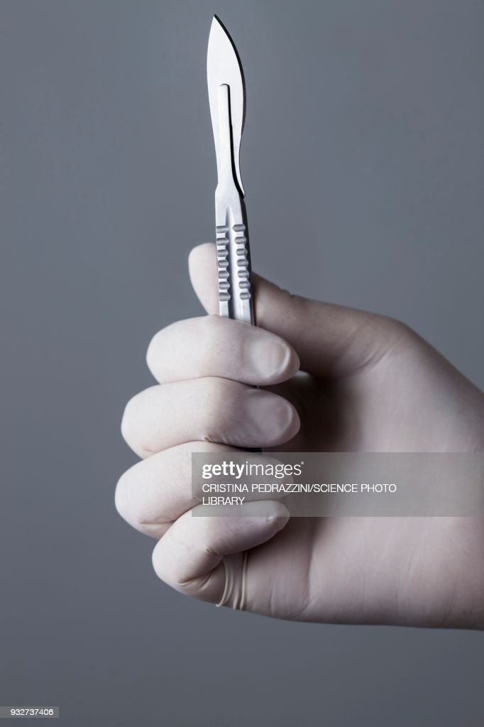Person holding scalpel : Stock Photo