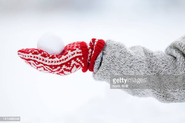 person holding snowball - mitten stock pictures, royalty-free photos & images