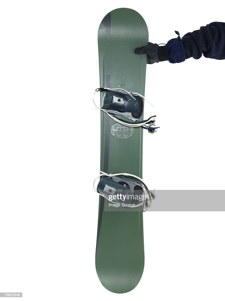 Person holding snowboard : Stock Photo