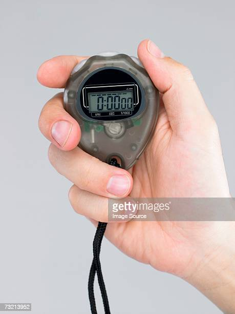 Person holding stop watch