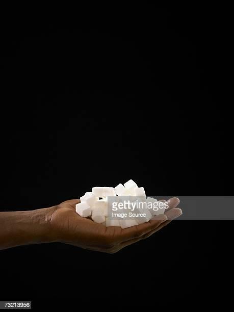 Person holding sugar lumps