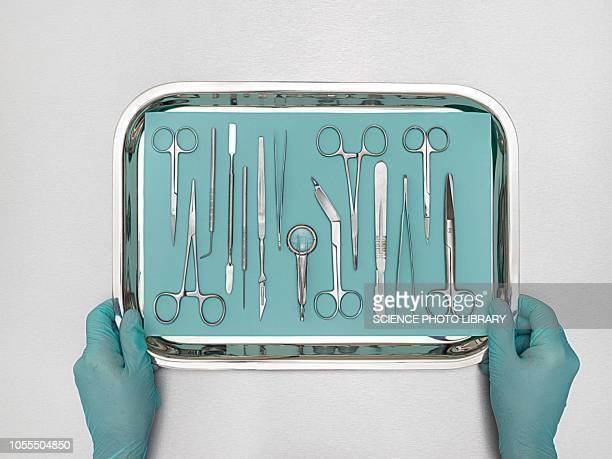 person holding tray with surgical equipment - surgical equipment stock photos and pictures