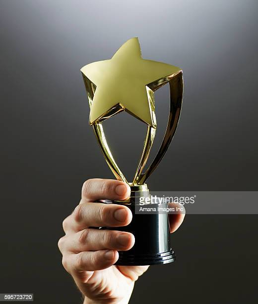 Person Holding Trophy