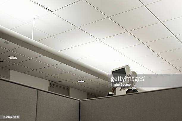 person holding up computer monitor in office - vernieling stockfoto's en -beelden