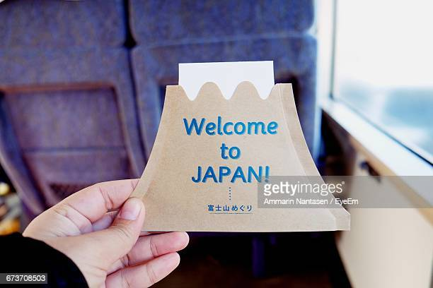 Person Holding Welcome Card On Journey