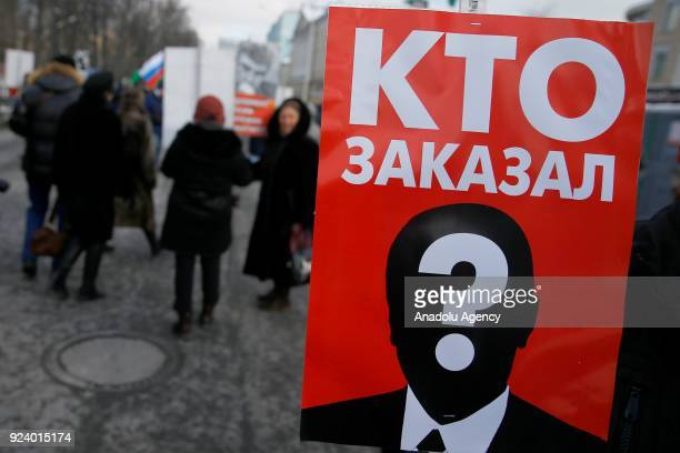 A person holds a banner during a memorial march for Boris Nemtsov to mark the third anniversary of his murder in Moscow Russia on February 25 2018