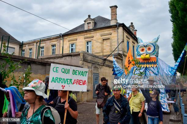 A person holds a banner reading 'What should happen Areva' as people take part in a demonstration against 'Cigeo' a huge center for burying nuclear...