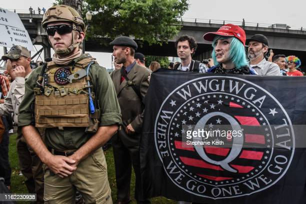 A person holds a banner referring to the Qanon conspiracy theory during a altright rally on August 17 2019 in Portland Oregon Antifascism...