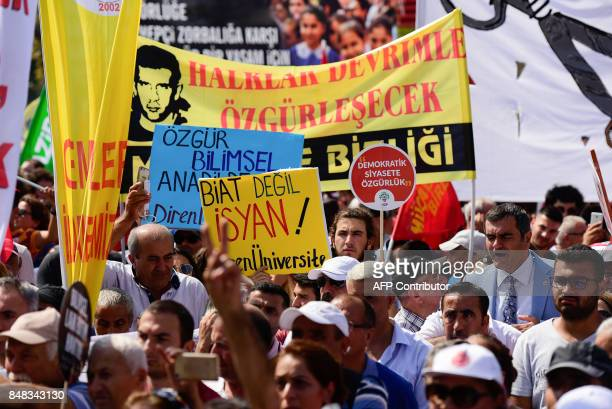 A person holds a placard reading ''Free scientific and secular education' during a protest against ruling Justice and Development Party 's education...