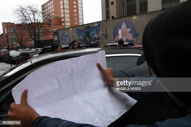 A person holds a sign as a car arrives with Irish Mixed Martial Arts fighter Conor McGregor at Brooklyn Court April 6 2018 in New York Irish Mixed...