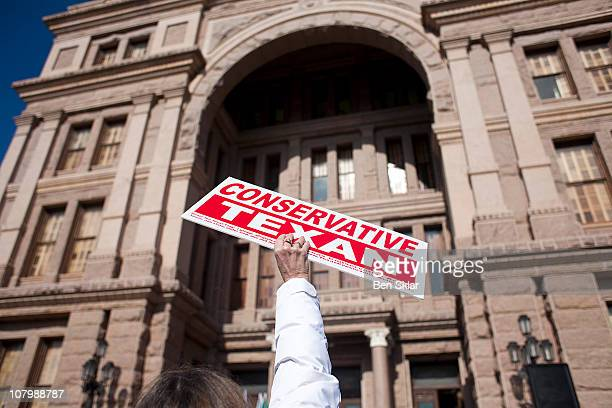 Person holds a sign as others belonging to the Tea Party movement convene at a rally at the Texas state capitol during the first day of the 82nd...