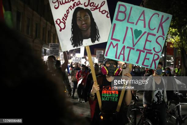 """Person holds a sign reading """"Black Lives Matter"""" during a rally at Nubian Square in the Roxbury neighborhood of Boston, MA on November 07, 2020. The..."""