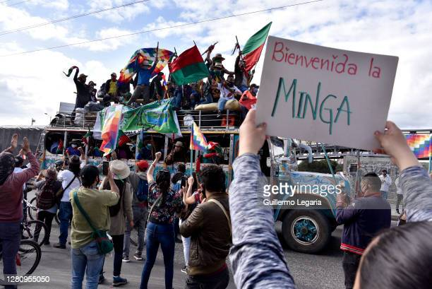 """Person holds a sign that reads """"Welcome, the Minga"""" as Colombian indigenous arrive to Bogotá demanding meeting with President Iván Duque October 18,..."""