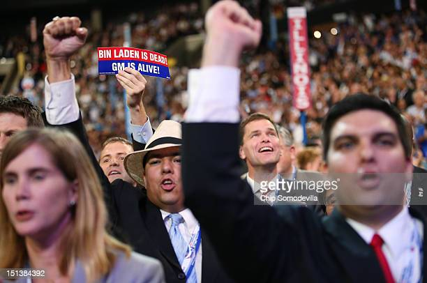 A person holds a sign that says 'Bin Laden Is Dead GM Is Alive' during the final day of the Democratic National Convention at Time Warner Cable Arena...