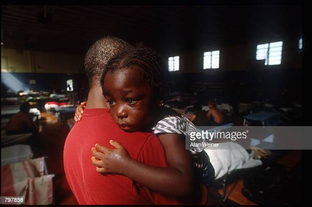 A person holds a young child in a shelter September 27 1989 in South Carolina Hugo is ranked as the eleventh most intense hurricane to strike the US...