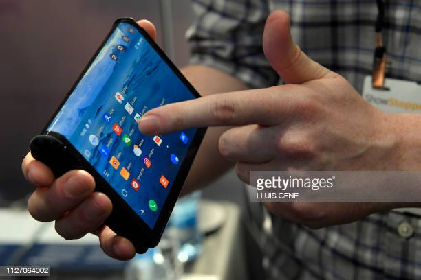 A person holds Americabased Chinese company Royole's foldable mobile device FlexiPai during the ShowStoppers @ MWC 2019 at the Mobile World Congress...