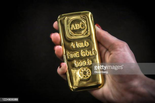 A person holds an ABC Bullion one kilogram gold bar at the ABC Refinery smelter in Sydney New South Wales Australia on Thursday July 2 2020 Western...