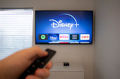 Person holds an Apple TV remote using the new Disney+ app on a Vizio TV. Disney+ video streaming service will exclusively show Star Wars: Jedi Template Challenge.
