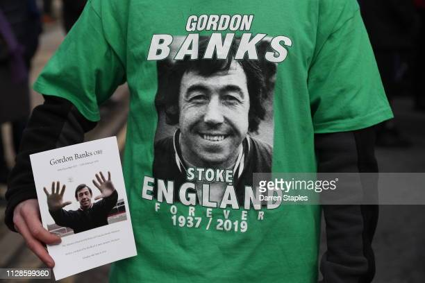 A person holds an order of service for former Stoke City and England goalkeeping legend Gordon Banks at the bet365 Stadium on March 04 2019 in Stoke...