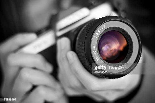 person holds camera - photographer stock photos and pictures
