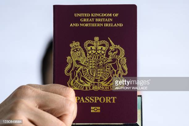 "Person holds up a British National passport in Hong Kong on January 29, 2021. - China on January 29 said it will ""no longer recognise"" the British..."