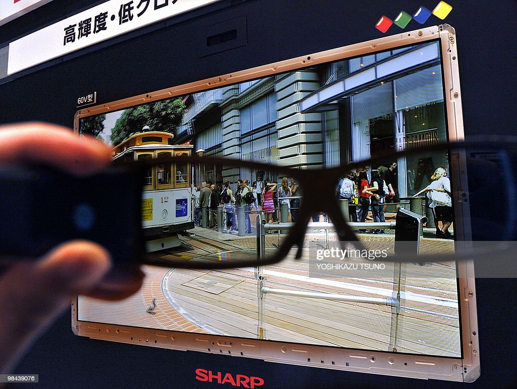 A person holds up special 3D glasses in : News Photo