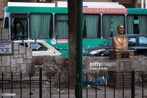 Person homeless sleeping in a Carlos Gardel a small square in the center of the city of Córdoba Argentina on July 28 2014