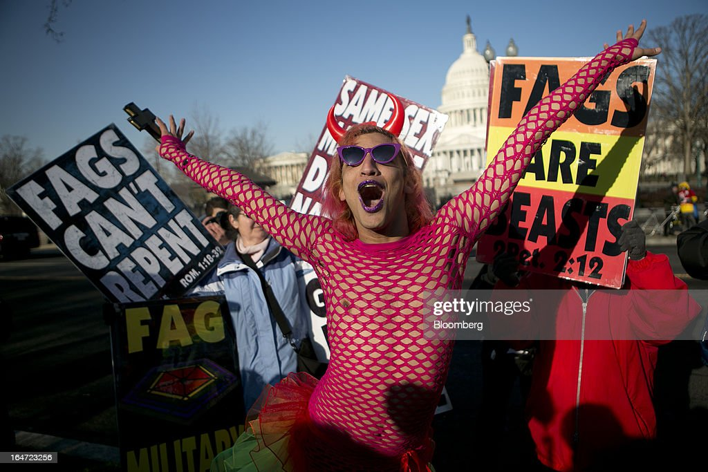 A person identifying themselves as Qween Amor of Orlando, Florida, dances next to opponents of same-sex marriage outside the U.S. Supreme Court in Washington, D.C., U.S., on Tuesday, March 26, 2013. The Supreme Court takes up what is probably its biggest civil-rights dispute in decades this week when it hears arguments that could lead to the legalization of same-sex marriage nationwide. Photographer: Andrew Harrer/Bloomberg via Getty Images