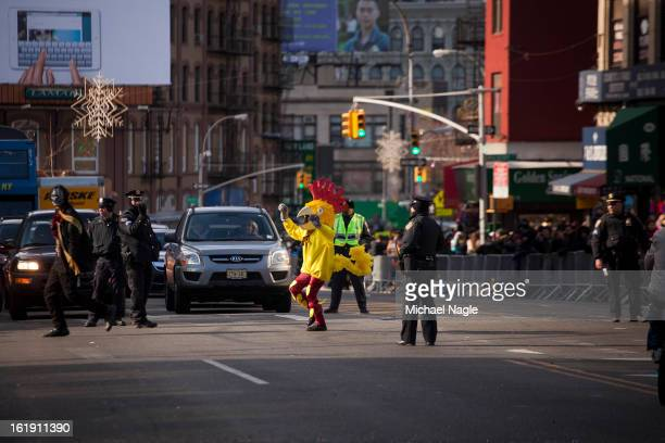 A person in a chicken costume crosses Canal Street during the 14th Annual Chinatown Lunar New Year Parade on February 17 2013 in New York City This...