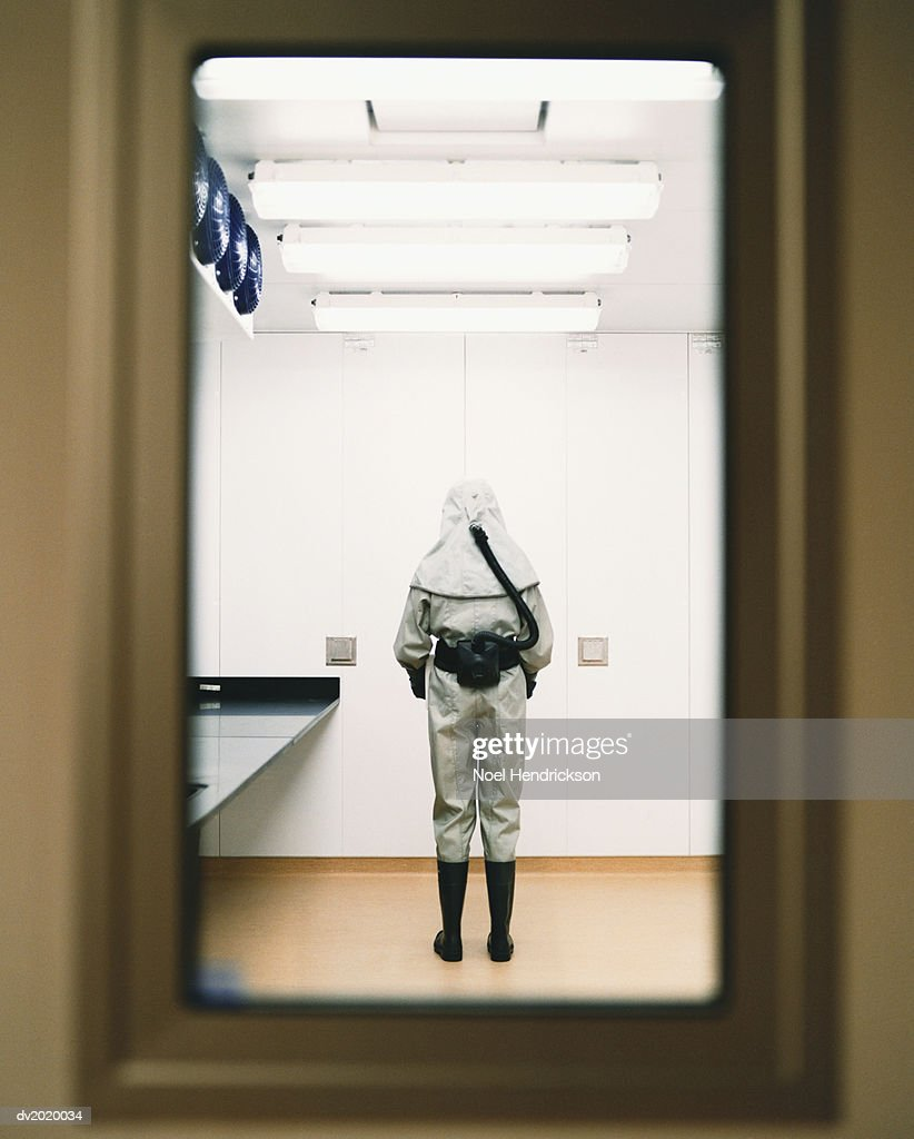 Person in a Lab Dressed in Protective Clothing : Stock Photo