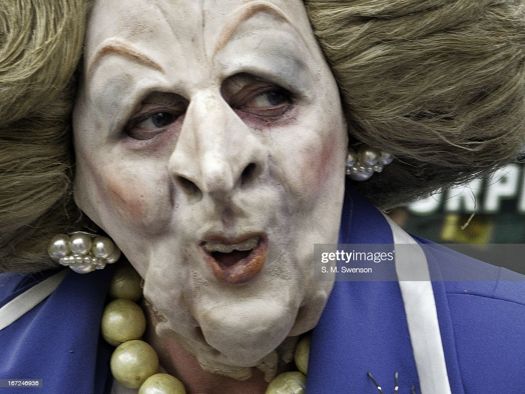 Content Person In A Margaret Thatcher Satire Mask With Her