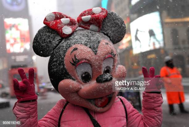A person in a Minnie Mouse mask poses Times Square in New York on March 21 as the fourth nor'easter in a month hits the tristate area on the first...