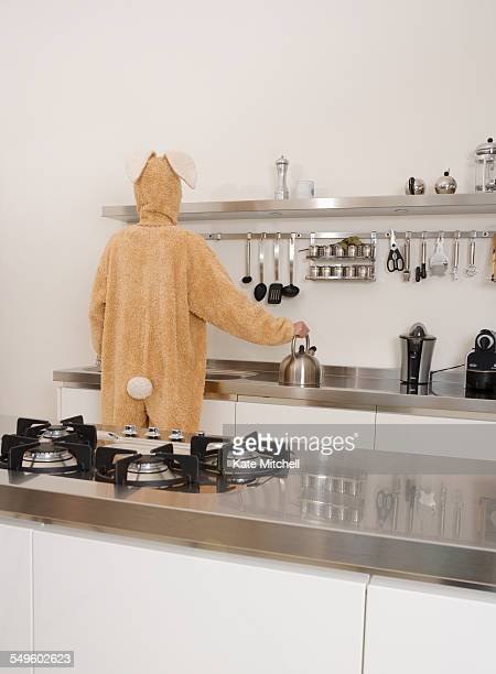 Person in Bunny Costume in Kitchen