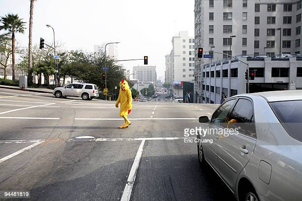 Person in chicken costume crossing the street