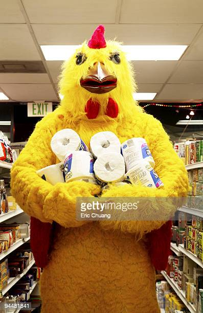 Person in chicken costume shopping for toilet paper