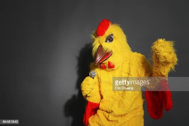 Person in chicken costume singing
