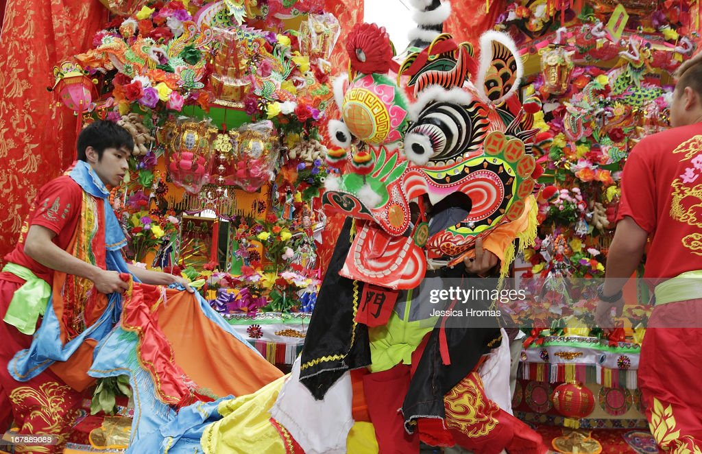 A person in Chinese lion costume dances by Tin Hau Temple, at the village of Shap Pat Heung as people celebrate and pay respects to Tin Hau on her Birthday on May 2, 2013 in Hong Kong, Hong Kong. Tin Hau is a gooddess of the sea and revered by fisherman and many Hong Kong people.